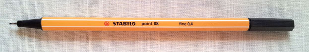 a Stabilo point 88 ink pen in a fine point